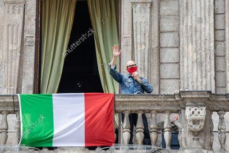 Italian musician Saturnino (Saturnino Celani) singings the popular protest song 'Bella ciao' from the balcony of Palazzo Marino (Milan's city hall)