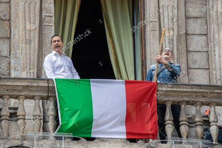 Stock Image of Milan Mayor Giuseppe 'Beppe' Sala (L) and Italian musician Saturnino (Saturnino Celani) singing the popular protest song 'Bella ciao' from the balcony of Palazzo Marino (Milan's city hall)