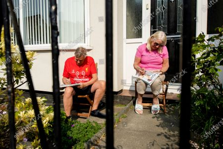 Residents of Dovercliff Road take part in games of Bingo held by neighbour David Walsh, in Liverpool, Britain, 25 April 2020.  During the Covid 19 pandemic members of the public have been finding various ways to entertain themselves whilst sticking to government guideline and observing social distancing.