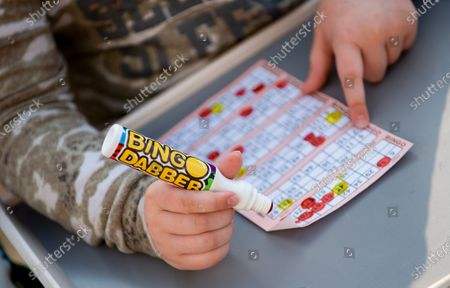 Residents of Dovercliff Road take part in games of Bingo held by neighbour David Walsh (L), in Liverpool, Britain, 25 April 2020.  During the Covid 19 pandemic members of the public have been finding various ways to entertain themselves whilst sticking to government guideline and observing social distancing.