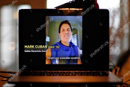 Stock Photo of University of Pittsburgh graduate Dallas Mavericks owner Mark Cuban congratulates members of the Class of 2020 during a virtual Commencement on a computer screen in Pittsburgh, . Every state except South Dakota, and 35 countries are represented in the almost 8,000 members of the Class of 2020