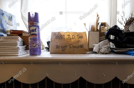 A container for identification tags in an office where funeral director Omar Rodriguez makes preparations for 30 bodies set for cremation to be picked up from the Gerald J. Neufeld Funeral Home by David Penepet, who has been helping area funeral homes overwhelmed by the number of people who have died, in the Elmhurst neighborhood of Queens, New York, USA, 26 April 2020. New York funeral homes have been overwhelmed by the massive increase in the number of dead as a result of the coronavirus and crematoriums in the city are unable to keep up. Penepet, a professor at the funeral services administration program at the State University of New York at Canton, has been taking bodies to crematoriums that are farther outside the city to help.