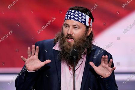 """Willie Robertson, CEO of Duck Commander and Buck Commander speaks during the opening day of the Republican National Convention in Cleveland. A man was arrested in connection with a drive-by shooting at the Louisiana home of """"Duck Dynasty"""" star Willie Robertson. Daniel King Jr. was booked into a correctional center after Robertson's estate in West Monroe was struck by gunfire on Friday afternoon, the Ouachita Parish Sheriff's Office said in a Facebook post . No one was injured in the shooting, authorities said"""