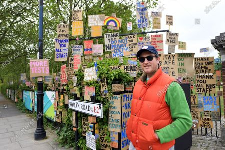 Artist Peter Liversidge, with his Sign Paintings for the NHS, Roman Road, East London.
