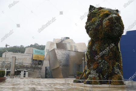 Stock Picture of The sculpture 'Puppy' by US artist Jeff Koons  at the entrance to the Guggenheim Museum in Bilbao, Spain, 27 April 2020.  Guggenheim's deputy director and chief officer for global strategies, Juan gnacio Vidarte, is optimistic about reopening the museum in June once the confinement ends step by step in May, and has announced the museum is studying to enlarge until the end of summer the four exhibitions that were currently programmed until May and June; the ones dedicated to Danish artist Olafur Eliasson, Brazilian painter Lygia Clark, US Richard Artschwger and South African William Kentdridge.