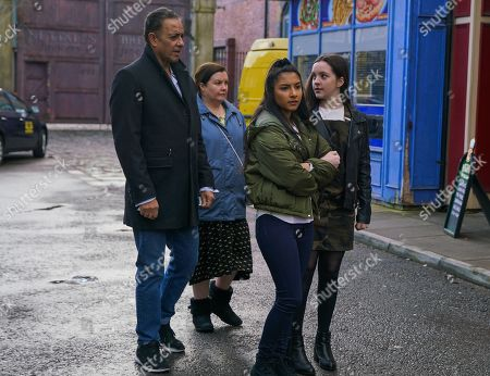 Stock Photo of Ep 10058 Wednesday 6th May 2020 As Asha Alahan, as played by Tanisha Gorey, Amy Barlow, as played by Elle Mulvaney, and Dev Alahan, as played by Jimmi Harkishin, head to the Community Centre, a couple of lads start pointing at Asha. Nina, as played by Mollie Gallagher, clocks them from outside the cafe, heads over and punches one of the lads on the nose.
