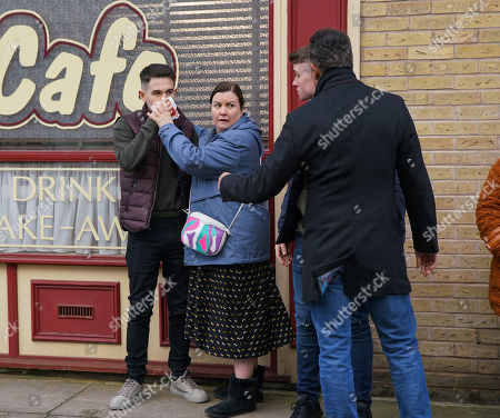 Ep 10058 Wednesday 6th May 2020 As Asha Alahan, Amy Barlow and Dev Alahan, as played by Jimmi Harkishin, head to the Community Centre, a couple of lads start pointing at Asha. Nina clocks them from outside the cafe, heads over and punches one of the lads on the nose.With Mary Cole, as played by Patti Clare.