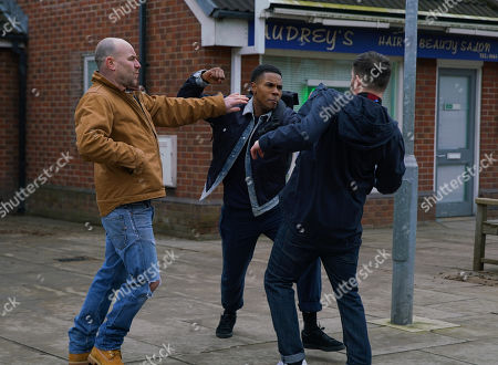Stock Image of Ep 10062 Friday 15th May 2020 As Tim Metcalfe, as played by Joe Duttine, chats to James Bailey, as played by Nathan Graham, about his last match, a County fan approaches and launches a tirade of homophobic abuse at James. Tim steps in and restrains James.