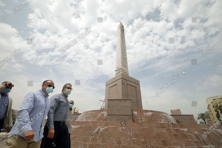 Mostafa Waziri, Secretary General of the Supreme Council of Antiquities (L) wearing face mask and Egyptian Minister of Antiquities Khaled Al Anany (R) check the work at the obelisk during the renovation of Tahrir Square, Cairo, Egypt, 27 April 2020. The Egyptian government in December 2019 issued a decision for the renovation of the iconic Tahrir square, that was the stage of anti-government protests that led to the ousting of former president Hosni Mubarak in 2011. The renovation process includes the relocating of four rams from Karnak Temple's Hall of Celebration in Luxor and an obelisk from Sun Al-Hajar in the east of Egypt, a decision that raised concerns from experts and archeologists.