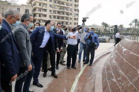 Egyptian Prime Minister Mostafa Madbouly (C) wearing face mask and Egyptian Minister of Antiquities Khaled Al Anany (2L) check the work at the obelisk during the renovation of Tahrir Square, Cairo, Egypt, 27 April 2020. The Egyptian government in December 2019 issued a decision for the renovation of the iconic Tahrir square, that was the stage of anti-government protests that led to the ousting of former president Hosni Mubarak in 2011. The renovation process includes the relocating of four rams from Karnak Temple's Hall of Celebration in Luxor and an obelisk from Sun Al-Hajar in the east of Egypt, a decision that raised concerns from experts and archeologists.
