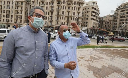 Mostafa Waziri, Secretary General of the Supreme Council of Antiquities (R) wearing face mask and Egyptian Minister of Antiquities Khaled Al Anany (L) check the work at the obelisk during the renovation of Tahrir Square, Cairo, Egypt, 27 April 2020. The Egyptian government in December 2019 issued a decision for the renovation of the iconic Tahrir square, that was the stage of anti-government protests that led to the ousting of former president Hosni Mubarak in 2011. The renovation process includes the relocating of four rams from Karnak Temple's Hall of Celebration in Luxor and an obelisk from Sun Al-Hajar in the east of Egypt, a decision that raised concerns from experts and archeologists.