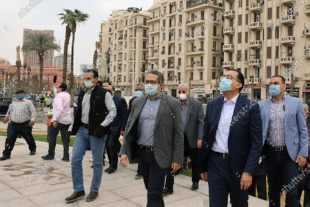 Egyptian Prime Minister Mostafa Madbouly (R) wearing face mask and Egyptian Minister of Antiquities Khaled Al Anany (2L) check the work at the obelisk during the renovation of Tahrir Square, Cairo, Egypt, 27 April 2020. The Egyptian government in December 2019 issued a decision for the renovation of the iconic Tahrir square, that was the stage of anti-government protests that led to the ousting of former president Hosni Mubarak in 2011. The renovation process includes the relocating of four rams from Karnak Temple's Hall of Celebration in Luxor and an obelisk from Sun Al-Hajar in the east of Egypt, a decision that raised concerns from experts and archeologists.