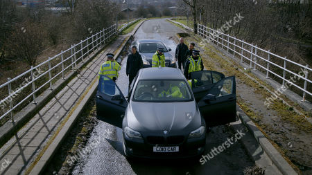 Stock Picture of Ep 8785 Monday 4th May 2020 On a country road, Cain Dingle, as played by Jeff Hordley, and Billy, as played by Jay Kontzle, are alarmed to see that there is a police car trying to pull them over. They soon realise it is Malone, as played by Mark Womack, and the chase is over. Billy and Cain's eyes glare into Malone's as they realise they?ve been set-up...