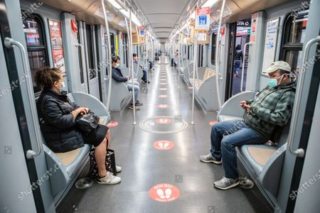 Signs and signals of social distancing on subway cars, as a form of containment