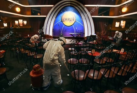"Crew technicians from ServiceMaster by ARS clean, sanitize and disinfect the Laugh Factory comedy club before a ""Laughter is Healing"" free stand-up comedy livestream event in Los Angeles. With comedy clubs closed and concert tours put on hold, comics like Craig Robinson, Tiffany Haddish, Will C and others are keeping the jokes flowing on webcasts and Zoom calls even without the promise of a payday, because they say the laughs are needed now more than ever"