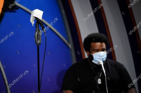 "Stock Image of Disinfectant wipe is placed over the microphone for the next performer as comedian Craig Robinson mans a keyboard onstage during a ""Laughter is Healing"" stand-up comedy livestream event at the Laugh Factory comedy club, in Los Angeles"