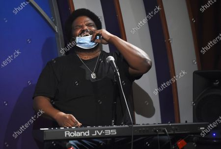 "Comedian Craig Robinson lowers his mask to laugh onstage during a ""Laughter is Healing"" free stand-up comedy livestream event at the Laugh Factory, in Los Angeles"