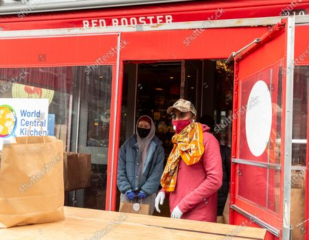 Renowed chef Marcus Samuelsson of Red Rooster restaurant helps distribute free food to needy people during COVID-19 pandemic in Harlem