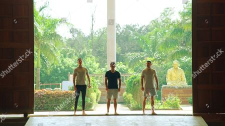 Scott Thomas, Ryan Thomas and Adam Thomas in a temple.