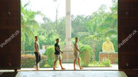 Scott Thomas, Ryan Thomas and Adam Thomas enter a temple.