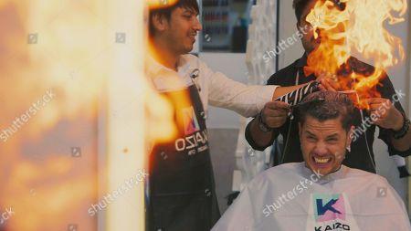 Scott Thomas gets a fire haircut.