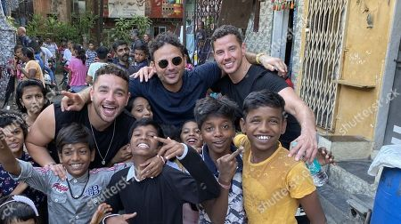 Adam Thomas, Ryan Thomas and Scott Thomas in Dharavi.