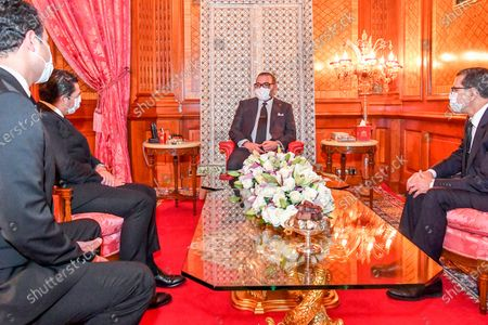 Stock Photo of In this photo released by the Moroccan Royal Palace Morocco's King Mohammed VI wears a face mask as he receives Saaid Amzazi, left, whom he assigns as government spokesperson and Othman El Firdaouss 2nd left, appointed new Minister of Culture, Youth and Sport at the Royal Palace in Casablanca, Morocco, . At right Morocco Prime Minister Saad Eddine el-Othmani looks on as he is wearing a compulsory face mask