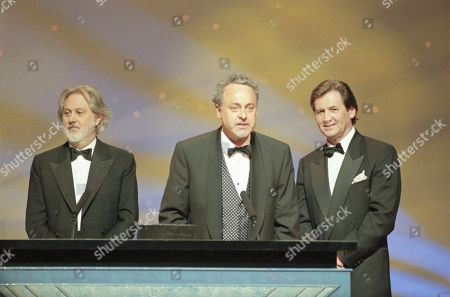 Gaetano Daniele, Producer of II Postino: The Postman, wins BAFTA for Best Foreign Language film, with David Putnam and Melvyn Bragg in b/g