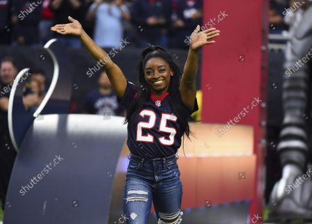 Olympic gymnast Simone Biles leading the Houston Texans onto the field before an NFL football game against the Tennessee Titans in Houston. Biles will participate in the Class of 2020 multi-hour graduation streaming event on Facebook and Instagram on May 15