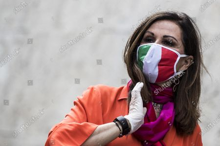Daniela Santanche of the Fratelli d'Italia (FdI) party with FdI parliamentarians demonstrates against the Italian government in front of the Chigi Palace in Rome, Italy, 28 April 2020. The Italian government announced a gradual lifting of the lockdown restrictions that were implemented to stem the widespread of the SARS-CoV-2 coronavirus that causes the COVID-19 disease, reports state. From 04 May 2020 on, the country's population will be again allowed access to parks and gardens, and to move around their own regions, among others; more restrictions are set to be lifted on 18 May and 01 June 2020.