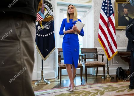 White House Press Secretary Kayleigh McEnany looks on as United States President Donald J. Trump makes remarks as he meets with Governor Ron DeSantis (Republican of Florida) in the Oval Office of the White House in Washington, DC,.