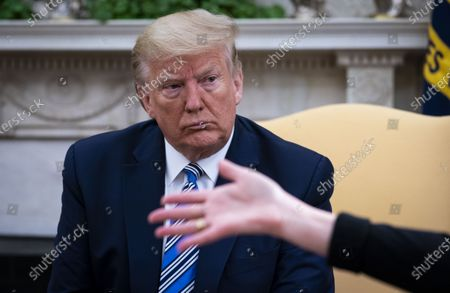 United States President Donald J. Trump looks on as Dr. Deborah L. Birx, White House Coronavirus Response Coordinator, makes remarks in the Oval Office of the White House in Washington, DC,.
