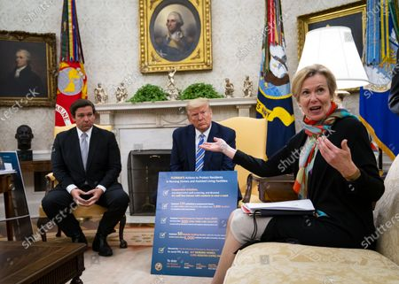 Dr. Deborah L. Birx, White House Coronavirus Response Coordinator, right, as United States President Donald J. Trump and Governor Ron DeSantis (Republican of Florida) look on during a meeting in the in the Oval Office of the White House in Washington, DC,.