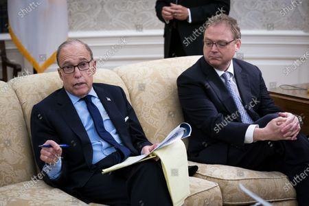 Director of the National Economic Council Larry Kudlow, left with Kevin A. Hassett, Chairman, Council of Economic Advisers, make remarks during a meeting with United States President Donald J. Trump and Governor Ron DeSantis (Republican of Florida) in the Oval Office of the White House in Washington, DC,.
