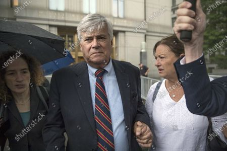 Dean Skelos, center, and his wife Gail, right, leave federal court in New York after being convicted on extortion, wire fraud and bribery charges. The former New York state Senate leader was released from prison to confinement at his Rockville Centre home after testing positive for the coronavirus