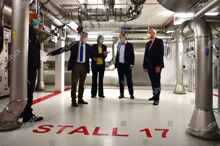 Minister President of Lower Saxony Stephan Weil (2-R) visits The University of Veterinary Medicine Hanover in Hannover, Germany, 29 April 2020. Scientists of the Veterinary university are searching for a vaccine against the SARS-CoV-2 coronavirus which causes the Covid-19 disease.