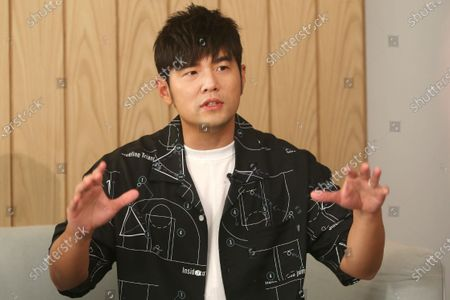 """Mandopop superstar Jay Chou gestures while talking about his latest Netflix show """"J-Style Trip"""" and life with his children during an interview with The Associated Press in Taipei, Taiwan"""