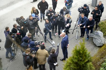 Stock Photo of Tom Hagen's lawyer Svein Holden (R) talks to the press at the police station at Lillestrom, Norway, 29 April 2020. Norwegian businessman Hagen was arrested the day before and charged with murder or complicity in the murder of his wife Anne-Elisabeth Hagen who has been missing for a year and a half.