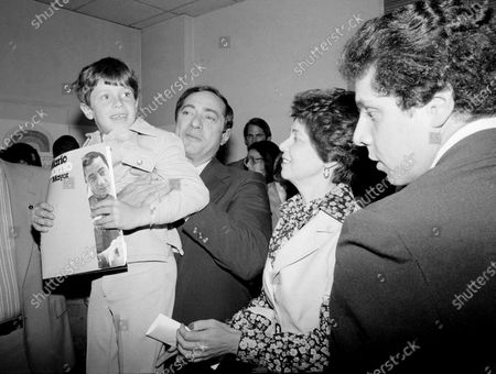 State Secretary of New York Mario Cuomo is shown during a press conference with his family, 1977. He holds up his son Christopher, 6. From left: Christopher Cuomo, Mario Cuomo, his wife Matilda, and their son Andrew, 19. Cuomo is running for mayor of New York City