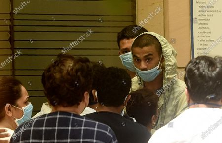 Babil Khan, son of Bollywood actor Irrfan Khan, right facing camera, stands outside Kokilaben Dhirubhai Ambani hospital after the news of his father's death, in Mumbai, India, . Irrfan Khan, a veteran character actor in Bollywood movies and one of India's best-known exports to Hollywood, died on Wednesday after being admitted to the hospital with a colon infection. He was 54