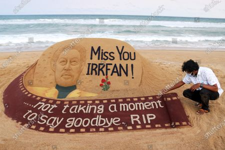 Indian sand artist Sudarsan Pattnaik touches up his sand artwork which he has made to pay tributes to the Indian actor Irrfan Khan, at the Puri beach in Orissa, India, 29 April 2020. Media reports state on 29 April 2020 that Bollywood actor Irrfan Khan has died at the age of 53 in Mumbai, India.