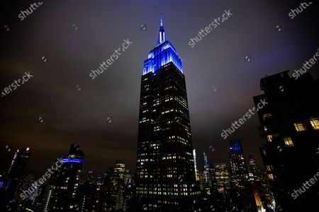 The Empire State Building shines bright blue light honoring New York City's MTA heroes in Manhattan during the COVID-19 outbreak