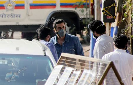 Bollywood actor Ranbir Kapoor, facing camera, speaks with Abhishek Bachchan after the cremation of his actor father Rishi Kapoor in Mumbai, India, . Top Indian actor Rishi Kapoor, a scion of Bollywood's most famous Kapoor family, has died. He was 67 and had leukemia