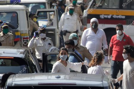 Bollywood actress Alia Bhatt arrives for the funeral of actor Rishi Kapoor in Mumbai, India, . Top Indian actor Kapoor, a scion of Bollywood's most famous Kapoor family, has died. He was 67 and had leukemia