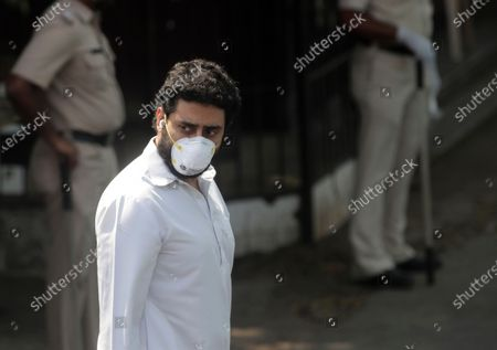 Bollywood actor Abhishek Bachchan leaves after the funeral of Rishi Kapoor in Mumbai, India, . Top Indian actor Rishi Kapoor, a scion of Bollywood's most famous Kapoor family, has died. He was 67 and had leukemia
