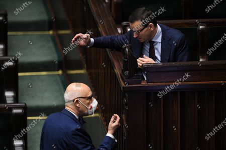 Polish Prime Minister Mateusz Morawiecki (R) and far-right Confederation leader Janusz Korwin-Mikke (L) converse in the meeting room during the second day of the 11th sitting of the Sejm (lower house of parliament) in the Polish Parliament building in Warsaw, Poland, 30 April 2020.