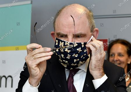 Minister of Justice Koen Geens tries on a face mask at a visit to a sewing workshop of Ferm, producing cotton mouth masks, in Wijgmaal, Thursday 30 April 2020. The government is stimulating people to produce home made mouth masks. Belgium is in its seventh week of confinement in the ongoing corona virus crisis. The government has announced a phased plan to attempt an exit from the lockdown situation in the country, continuing to avoid the spread of Covid-19.