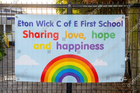 Rural primary school Eton Wick C of E First School puts posters around the perimeter of the school that say 'Sharing love, hope and happiness' during the Coronavirus Pandemic Lockdown