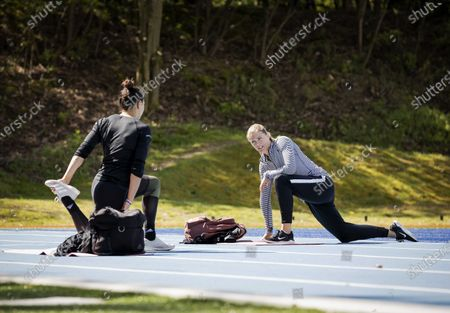 Dutch athletes Naomi Sedney (L) and Dafne Schippers (R) train during the reopening of the Papendal sports center in Arnhem, The Netherlands, 30 April 2020, during the coronavirus (COVID-19) pandemic. A group of selected individual elite athletes have been welcomed to start training in small controlled groups and under strict observance of the RIVM (Netherlands National Institute for Public Health and the Environment) guidelines.