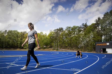 Dutch athletes Dafne Schippers (L) and Naomi Sedney (R) train during the reopening of the Papendal sports center in Arnhem, The Netherlands, 30 April 2020, during the coronavirus (COVID-19) pandemic. A group of selected individual elite athletes have been welcomed to start training in small controlled groups and under strict observance of the RIVM (Netherlands National Institute for Public Health and the Environment) guidelines.